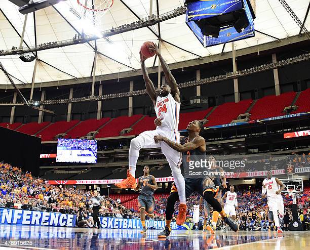 Casey Prather of the Florida Gators drives to the basket against Antonio Barton of the Tennessee Volunteers during the semifinals of the SEC Men's...
