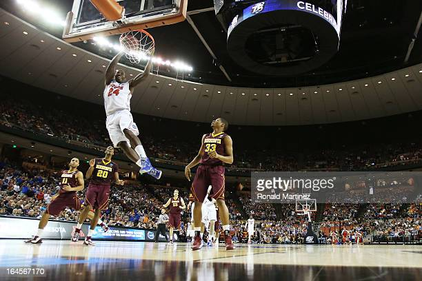 Casey Prather of the Florida Gators dunks on the Minnesota Golden Gophers in the first half during the third round of the 2013 NCAA Men's Basketball...