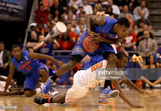 Casey Prather of the Florida Gators grabs the ball in front of Russ Smith of the Louisville Cardinals in the second half during the 2012 NCAA Men's...