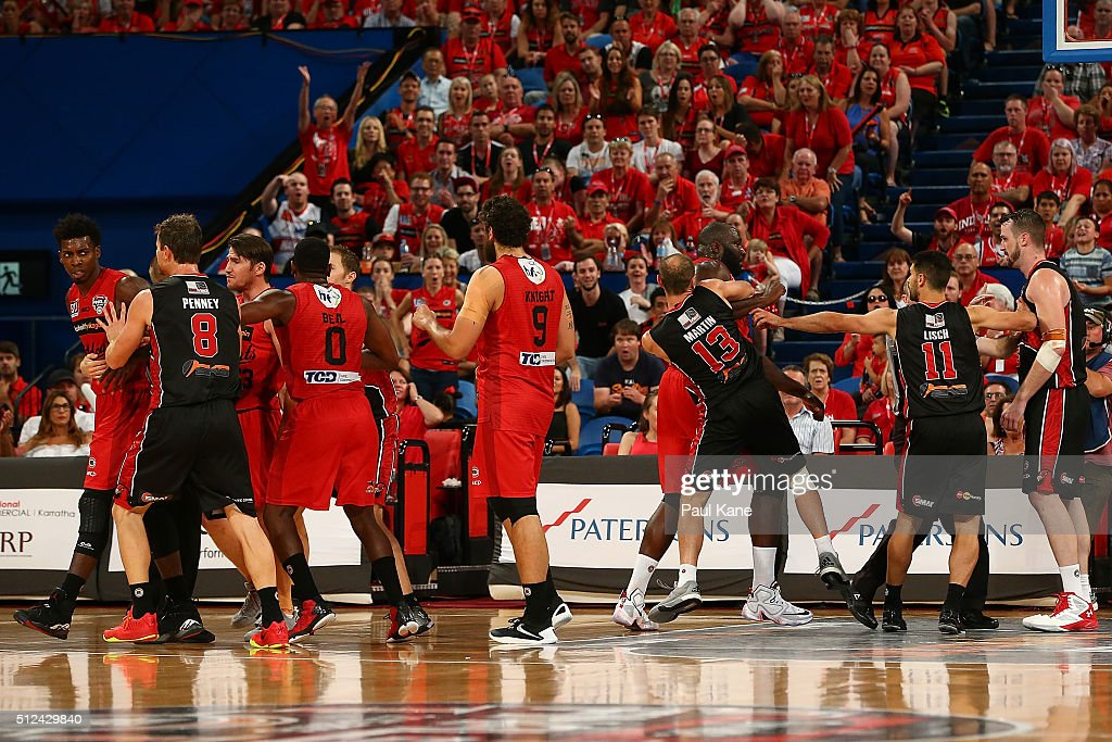 Casey Prather of the Wildcats and Andrew Ogilvy of the Hawks are separated by team mates during the NBL Semi Final match between Perth Wildcats and Illawarra Hawks at Perth Arena on February 26, 2016 in Perth, Australia.