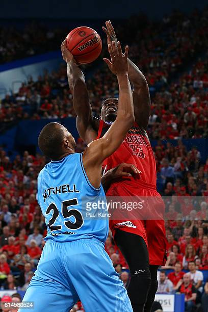 Casey Prather of the Wildcats drives to the basket against Akil Mitchell of the Breakers during the round two NBL match between the Perth Wildcats...