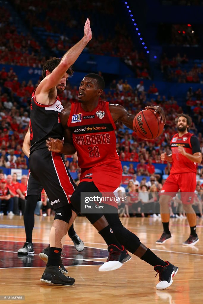 Casey Prather of the Wildcats drives to the basket against Kevin White of the Hawks during game one of the NBL Grand Final series between the Perth Wildcats and the Illawarra Hawks at Perth Arena on February 26, 2017 in Perth, Australia.