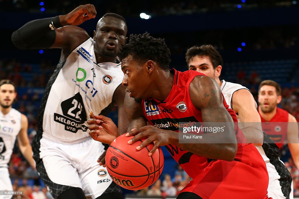 Casey Prather of the Wildcats drives to the basket against Majok Majok of United during the round 10 NBL match between the Perth Wildcats and Melbourne United at Perth Arena on December 10, 2015 in Perth, Australia.