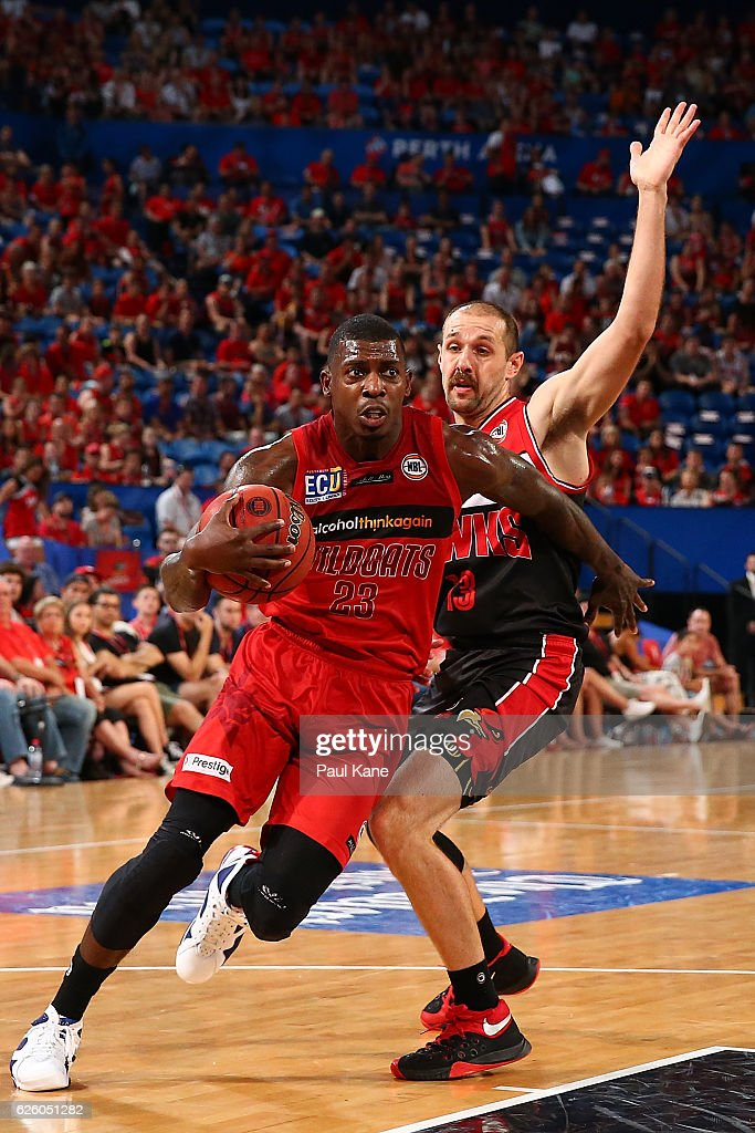 Casey Prather of the Wildcats drives to the basket against Rhys Martin of the Hawks during the round eight NBL match between the Perth Wildcats and the Illawarra Hawks at the Perth Arena on November 27, 2016 in Perth, Australia.