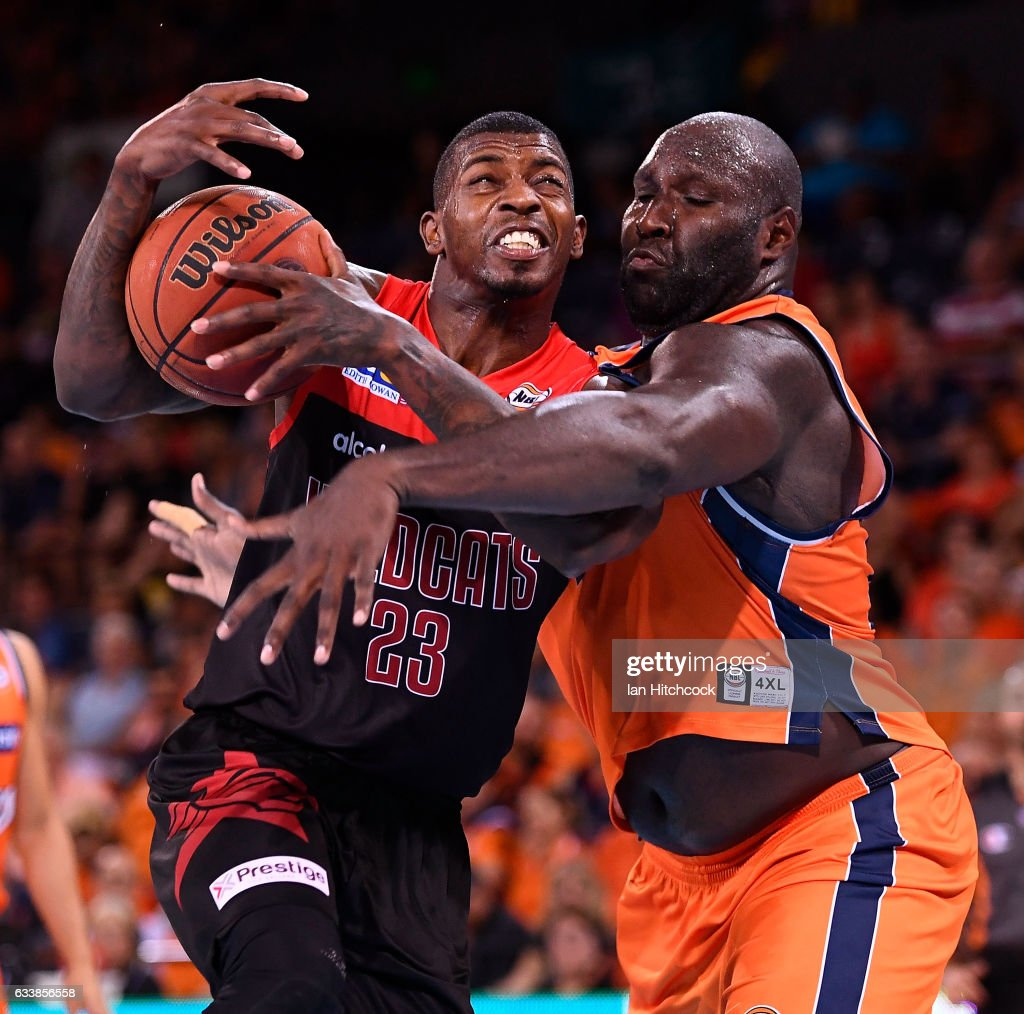 Casey Prather of the Wildcats drives to the basket past Nathan Jawai of the Taipans during the round 18 NBL match between the Cairns Taipans and the Perth Wildcats at the Cairns Convention Centre on February 5, 2017 in Cairns, Australia.