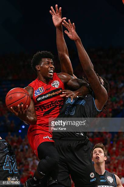 Casey Prather of the Wildcats lays up agaisnt Charles Jackson of the Breakers during game one of the NBL Grand FInal series between the Perth...