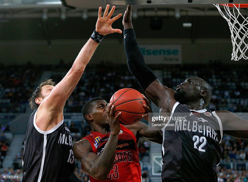 Casey Prather of the Wildcats puts up a shot against Majok Majok of Melbourne United and David Andersen of Melbourne United during the round three NBL match between Melbourne United and the Perth Wildcats at Hisense Arena on October 23, 2016 in Melbourne, Australia.
