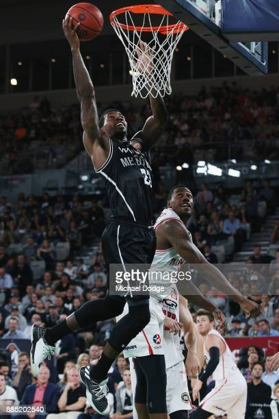 Casey Prather of United drivres to the basket past Delvon Johnson of the Hawks during the round eight NBL match between Melbourne United and the...