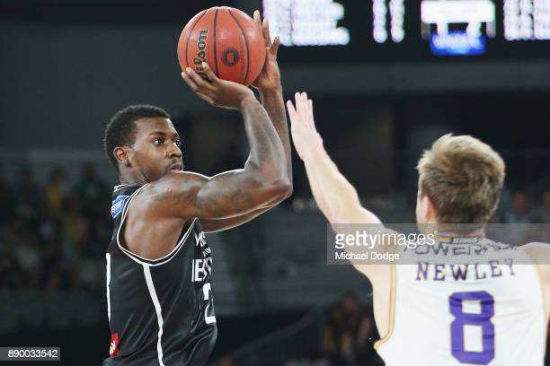 Casey Prather of United shotts over Brad Newley of the Kings during the round nine NBL match between Melbourne United and the Sydney Kings at Hisense...