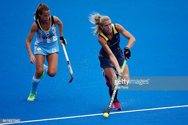 Casey Sablowski of Australia goes past Delfina Merino of Argentina during the FIH Women's Hockey Champions Trophy 2016 match between Australia and...