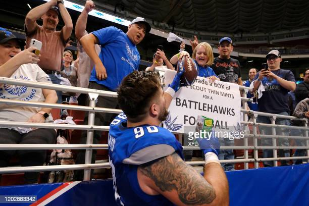 Casey Sayles of the St Louis BattleHawks fulfilled a wish from a young fan holding a sign saying she would trade a box of Girl Scout Thin Mints for a...
