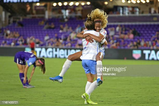 Casey Short of Chicago Red Stars celebrates her game winning goal with teammate Savannah McCaskill in front of Joanna Boyles of Orlando Pride during...
