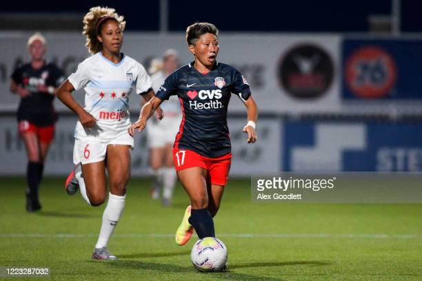 Casey Short of Chicago Red Stars chases Kumi Yokoyama of the Washington Spirit in the first round of the NWSL Challenge Cup at Zions Bank Stadium on...