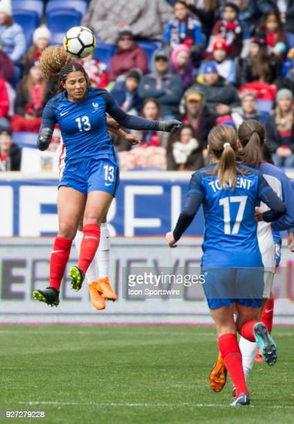 Casey Short of the USWNT heads the ball behind Valerie Gauvin of France during a She Believes Cup match between the USWNT and France on March 04 at...