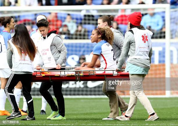 Casey Short of United States of America is carried off the field after she is injured in the second half against France during the SheBelieves Cup at...