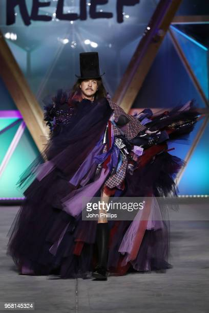 Casey Spooner walks the Runway at Fashion for Relief Cannes 2018 during the 71st annual Cannes Film Festival at Aeroport Cannes Mandelieu on May 13...