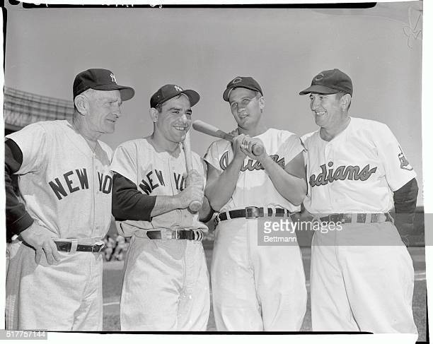 Casey Stengel and Yogi Berra of the Yankees pose with Al Rosen and Al Lopez of the Cleveland Indians