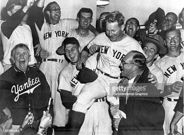 CLEVELAND OH SEPTEMBER 1955 Casey Stengel is shouting far left Whitey Ford is bein hoisted on some shoulders in the New York Yankees celebration of...