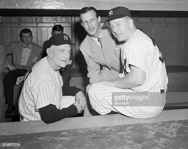 Casey Stengel manager of the New York Yankees gives last minute instructions to Ed Lopat his pitcher for today in the second World Series game...