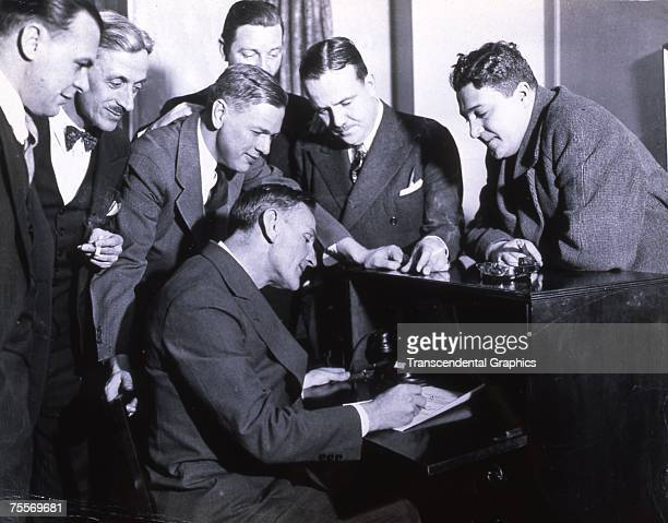 BOSTON JANUARY 1924 Casey Stengel outfielder for the New York Giants is surrounded by team officials as he signs a contract to play for the Boston...