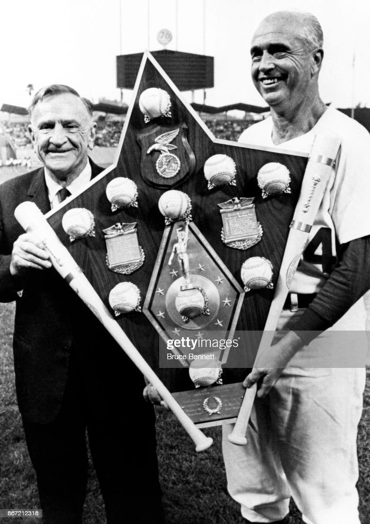 Casey Stengel presents manager Walter Alston #24 of the Los Angeles Dodgers with a trophy after he managed the 1966 National League All-Stars on July 20, 1966 at Dodger Stadium in Los Angeles, California.