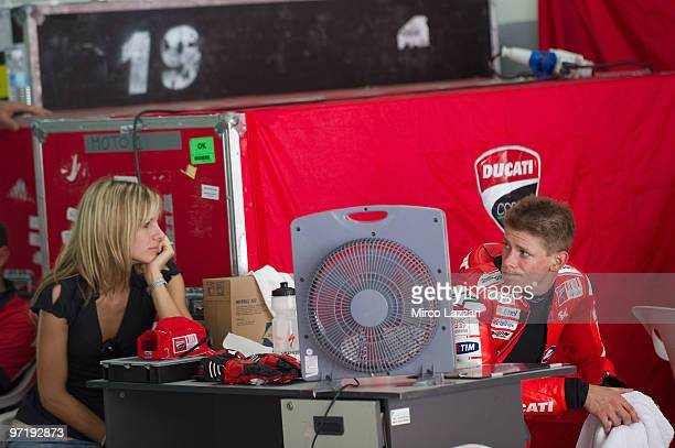 Casey Stoner and his wife Adriana of Australia and Ducati Marlboro Team look on in box during the day of testing at Sepang Circuit on February 26...