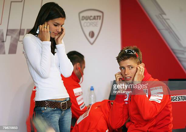 Casey Stoner and his wife Adriana sit in the Ducati Team garage during MotoGP Testing at the Circuito de Jerez on February 18 2008 in Jerez Spain