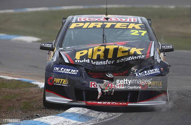 Casey Stoner driver of the Red Bull Pirtek Holden comes to a stop after crashing out at the start of race five of the Dunlop Development Series at...