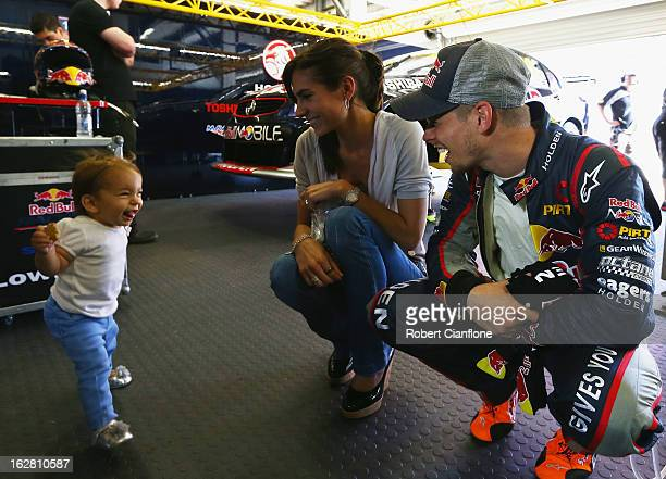 Casey Stoner driver of the Red Bull Pirtek Holden is seen with his wife Adriana and baby daughter Alessandra Maria after practice for round one of...
