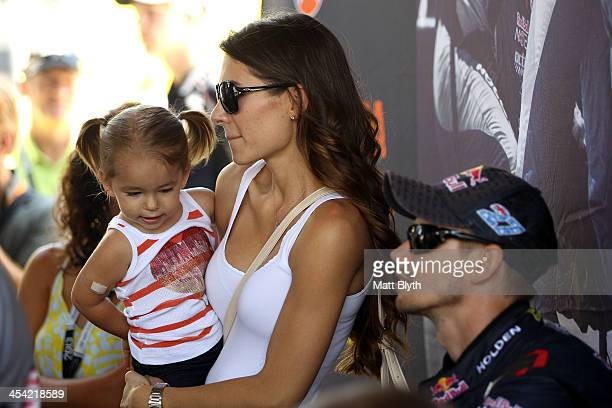 Casey Stoner driver of the Red Bull Pirtek Holden is seen with his wife Adriana and daughter Alessandra Maria prior to the Dunlop Development Series...