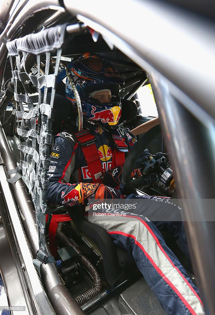 Casey Stoner driver of the #27 Red Bull Pirtek Holden sits in his car prior to practice for round one of the V8 Supercars Dunlop Development Series at the Adelaide Street Circuit on February 28, 2013 in Adelaide, Australia.