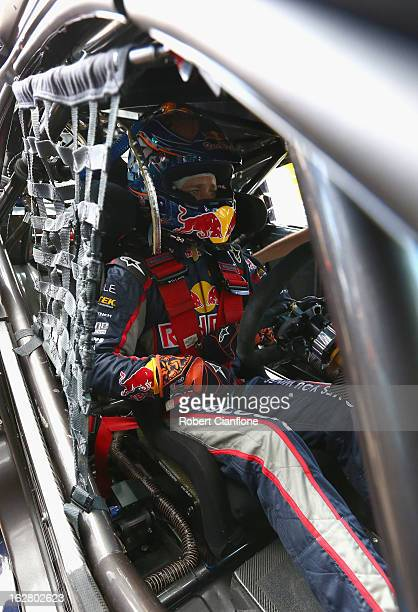 Casey Stoner driver of the Red Bull Pirtek Holden sits in his car prior to practice for round one of the V8 Supercars Dunlop Development Series at...