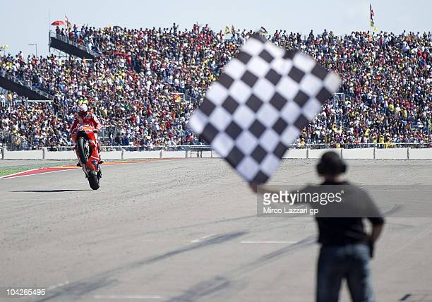 Casey Stoner of Australia and Ducati Marlboro Team cuts the finish lane and celebrates the victory at the end of MotoGP race of MotoGP of Aragon at...
