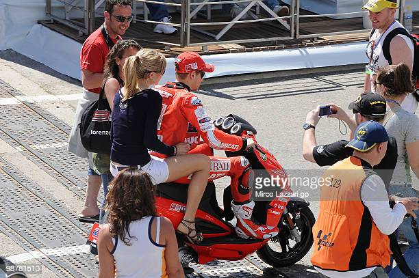 Casey Stoner of Australia and Ducati Marlboro Team rides the scooter in paddock with his wife Adriana at Circuito de Jerez on May 1 2010 in Jerez de...
