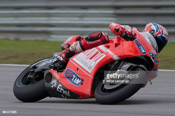 Casey Stoner of Australia and Ducati Marlboro Team rounds the bend during the final day of the MotoGP test at Sepang International Circuit on...