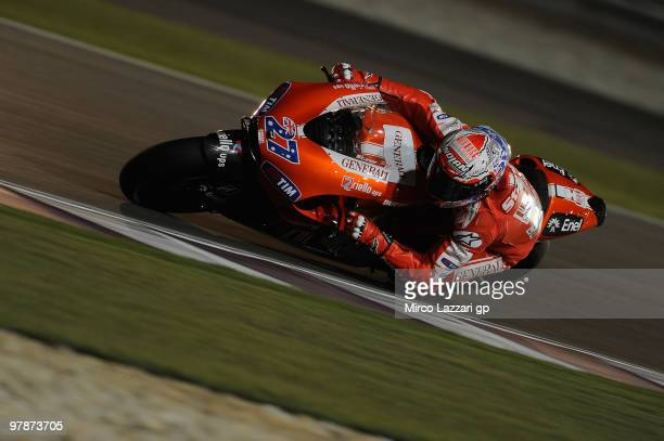 Casey Stoner of Australia and Ducati Marlboro Team rounds the bend during the third day of testing at Losail Circuit on March 19, 2010 in Doha, Qatar.