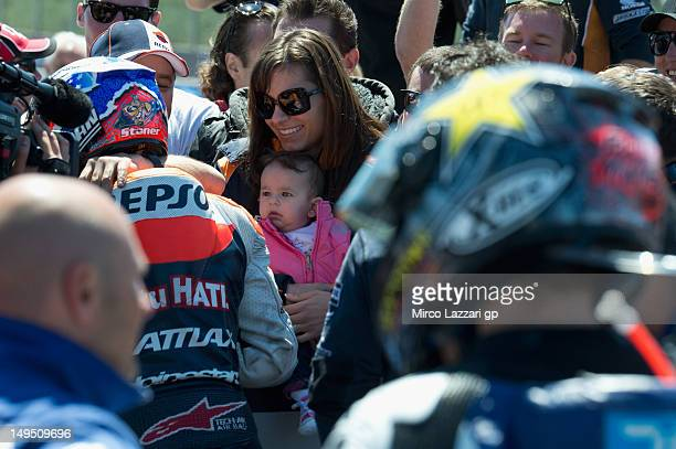 Casey Stoner of Australia and Repsol Honda Team celebrates the victory with his wife Adriana and his doughter Alessandra Maria at the end of the...