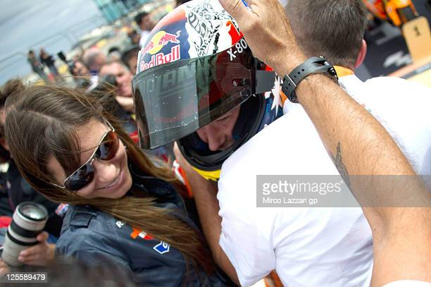 Casey Stoner of Australia and Repsol Honda Team celebrates with his mechanics and wife Adriana under the podium at the end of the MotoGP race of...