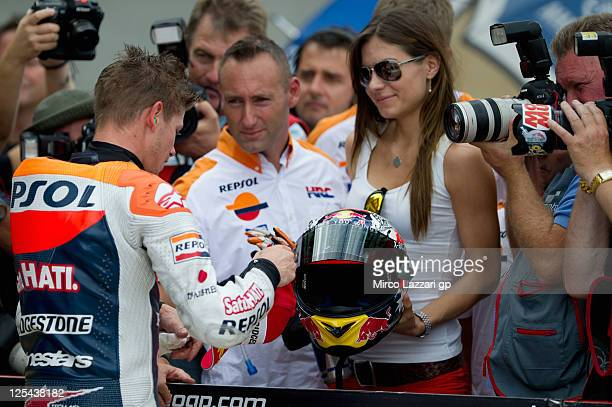 Casey Stoner of Australia and Repsol Honda Team celebrates with team and his wife Adriana at the end of the qualifying practice of the MotoGP of...