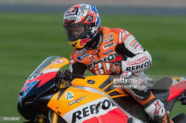 Casey Stoner of Australia and Repsol Honda Team displays a number 58 on his leathers in tribute to Italian rider Marco Simoncelli as he heads down a...