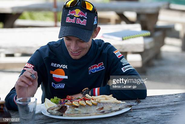 Casey Stoner of Australia and Repsol Honda Team eats during the preevent 'Trout fishing' prior to the Australian MotoGP which is round 16 of the...