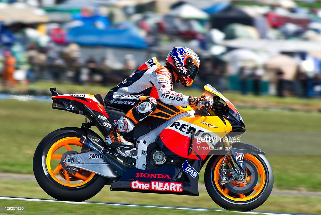 Casey Stoner of Australia and Repsol Honda Team heads down a straight during the qualifying practice for the Australian MotoGP, which is round 16 of the MotoGP World Championship, at Phillip Island Grand Prix Circuit on October 15, 2011 in Phillip Island, Australia.