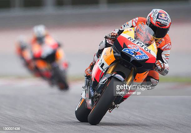 Casey Stoner of Australia and Repsol Honda Team leads the field during the MotoGP race of MotoGP of Malaysia at Sepang Circuit on October 23, 2011 in...