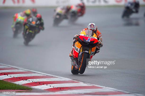 Casey Stoner of Australia and Repsol Honda Team leads the field during the MotoGP race during the MotoGP Of Malaysia at Sepang Circuit on October 21,...