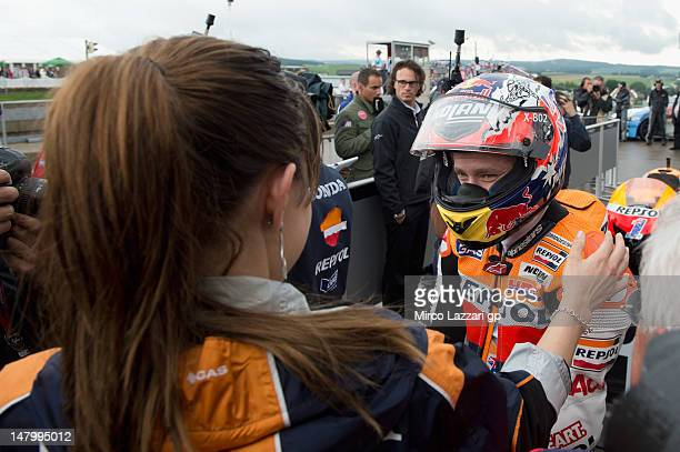 Casey Stoner of Australia and Repsol Honda Team looks on Adriana Stoner at the end of the qualifying practice of the MotoGp of Germany at Sachsenring...