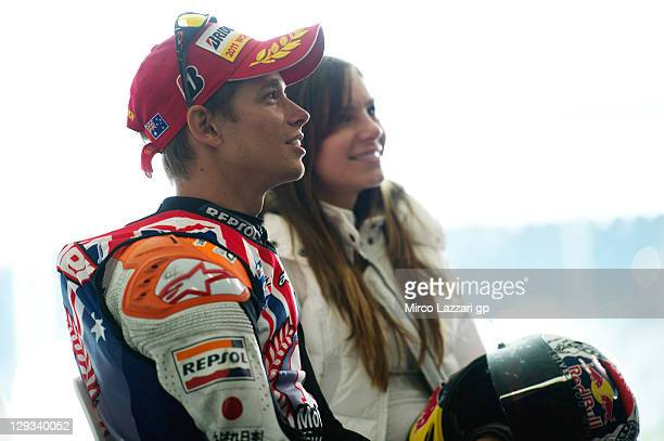 Casey Stoner of Australia and Repsol Honda Team looks on beside his wife Adriana Stoner during the press conference after winning the race and the...