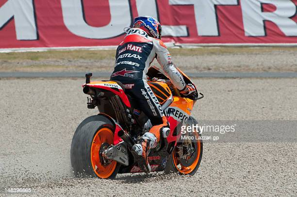 Casey Stoner of Australia and Repsol Honda Team rides out of a run off area during the MotoGP race of the MotoGP of Italy at Mugello Circuit on July...
