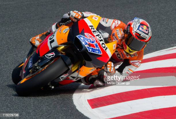Casey Stoner of Australia and Repsol Honda Team rounds the bend during the qualifying practice of MotoGp Of Catalunya at Circuit de Catalunya on June...