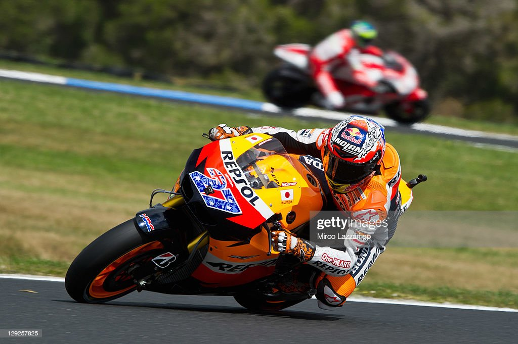 Casey Stoner of Australia and Repsol Honda Team rounds the bend during the qualifying practice for the Australian MotoGP, which is round 16 of the MotoGP World Championship, at Phillip Island Grand Prix Circuit on October 15, 2011 in Phillip Island, Australia.