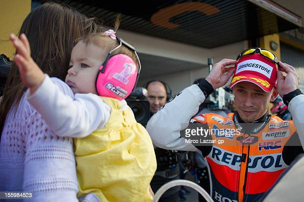 Casey Stoner of Australia and Repsol Honda Team smiles at his wife Adriana Stoner and daughter Alessandra Maria at the end of the qualifying practice...